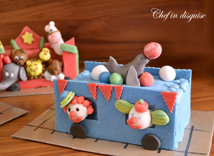 clowns cart train cake