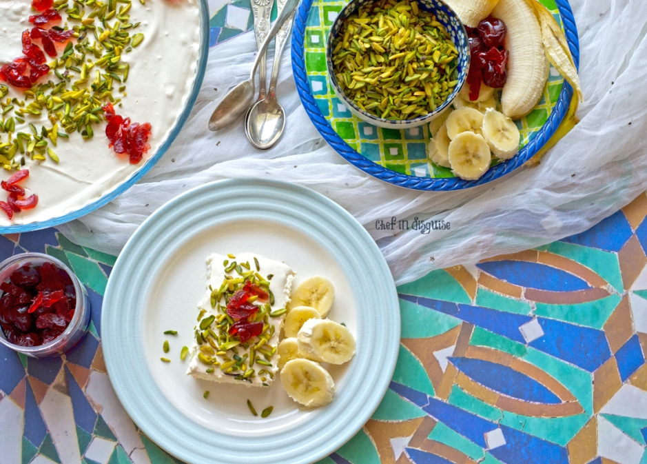 Madlouka or lebanese nights dessert a velvety smooth semolina pudding topped with cream, pistachios, fruits and it is then drizzled with syrup.jpg