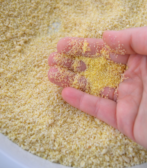 Note the difference in the size of the bulgur in my hand and the maftoul granules in the pan