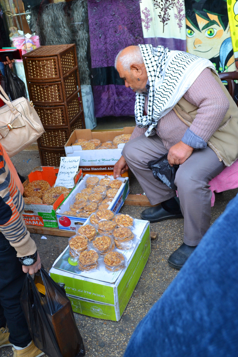 An old man selling sesame brittle  on the streets of Nablus