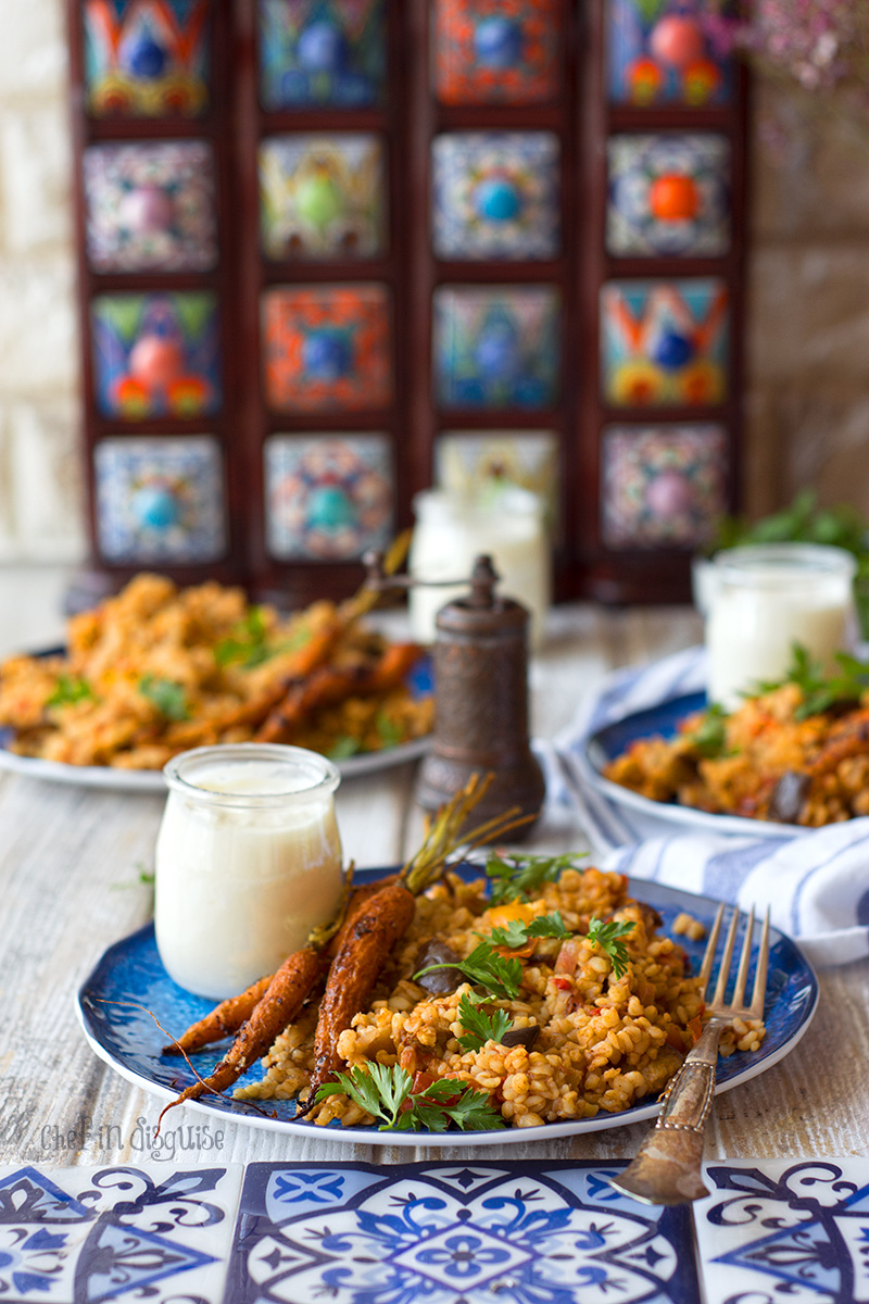 Eggplant bulgur pilaf. Creamy eggplant, warm spices and earthy nutty bulgur served with garlic sumac baby carrots and greek yogurt. A true feast for the taste buds