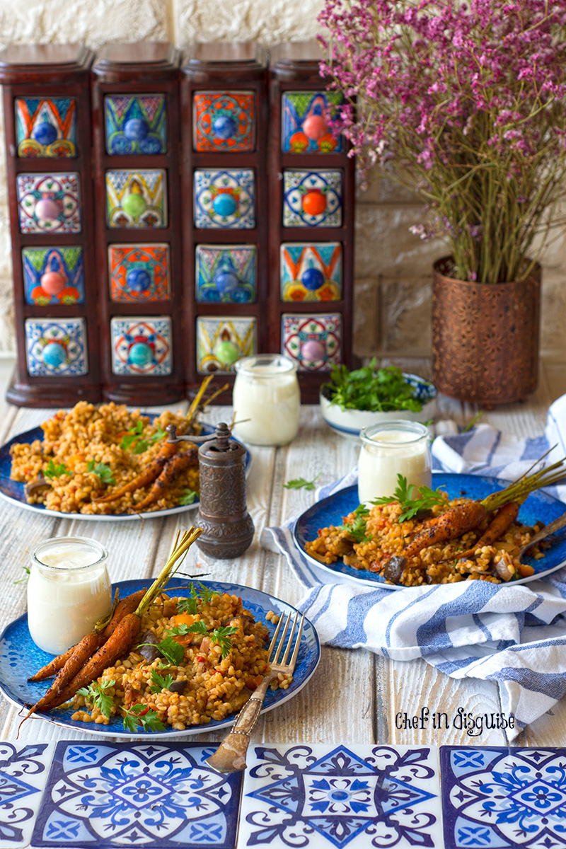 Middle eastern eggplant bulgur pilaf. Creamy eggplant, warm spices and earthy nutty bulgur served with garlic sumac baby carrots and greek yogurt. A true feast for the taste buds