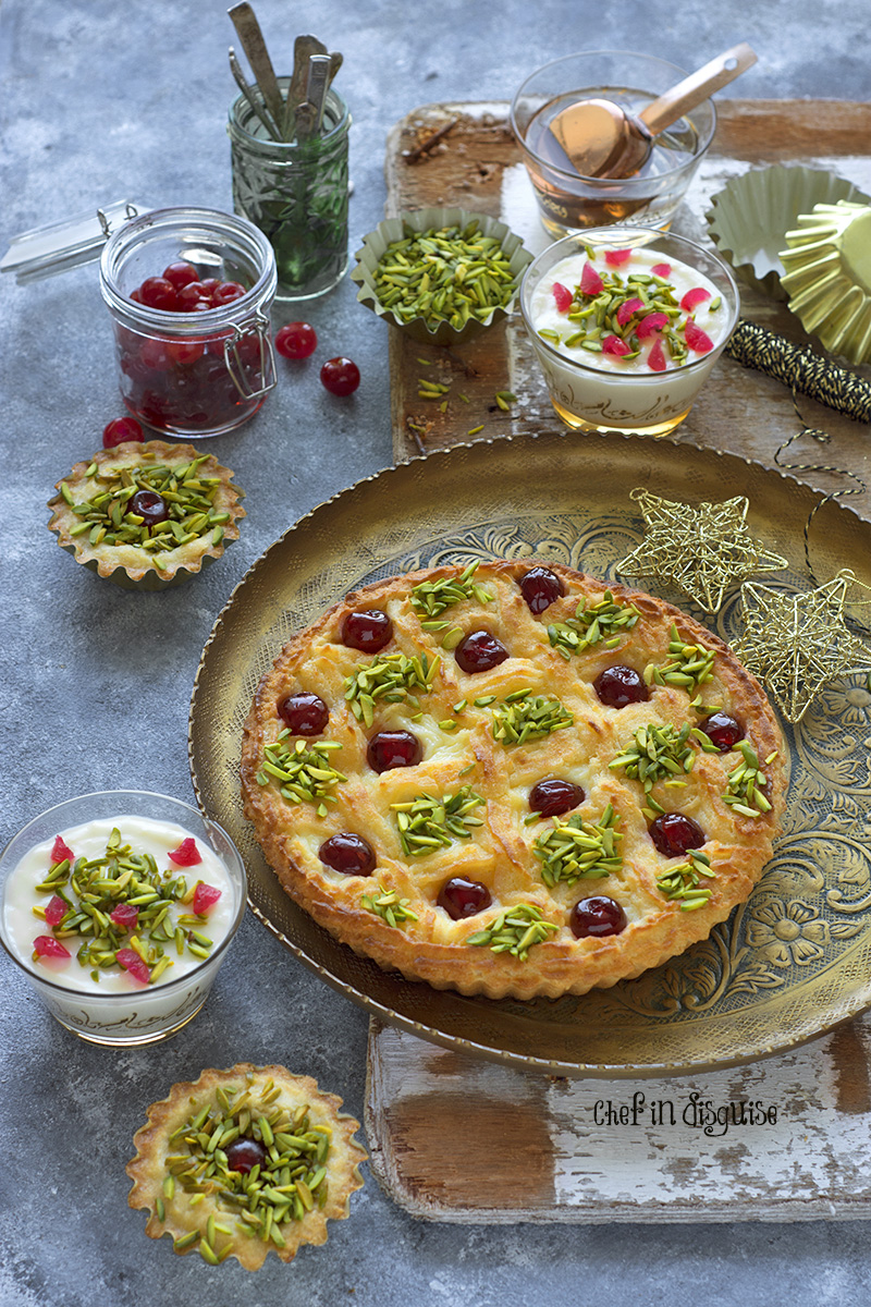 3 desserts in one! the crust is a cross between basbousa/ harissa and a cake. The filling is a thick muhalabia (milk pudding) that provides the perfect contrast in color and texture to the golden brown crust. A feast for the eyes and taste buds