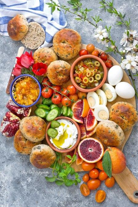 Breakfast platter with zaatar rolls , fruits and eggs